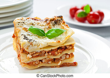 Lasagne - Portion of lasagna with meat topped with parmesan