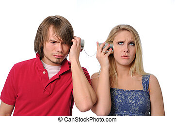 Miscommunication Between Young Couple - Young couple using a...