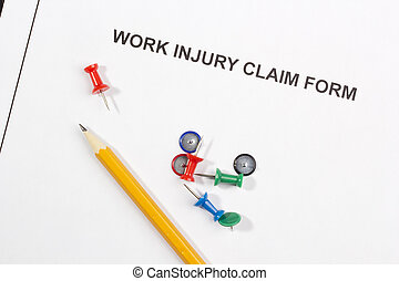 Work Injury Claim Form - Directly above photograph of a work...