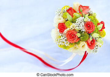 bouquet of rad roses on the white wedding dress - bouquet of...