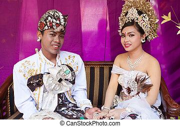 Balinese wedding - BALI - FEBRUARY 11. Couple enacting...