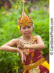 Balinese dancer - Young Balinese female dancer performing...