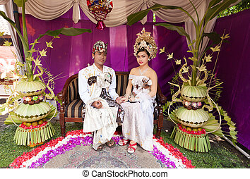 Balinese wedding - BALI - FEBRUARY 11. Couple enacting...