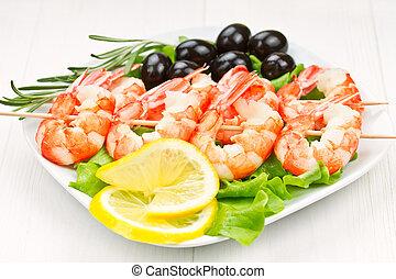 tiger prawns on a skewer with olives