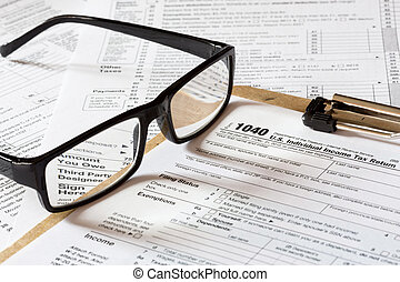 1040 tax form with reading glasses