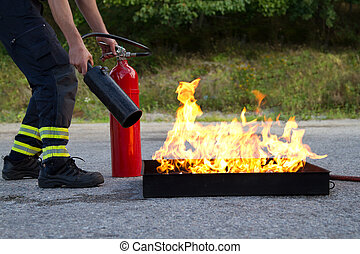 Fire training - Instructor showing how to use a fire...