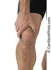 man with knee pain - Young man having knee pain in a...