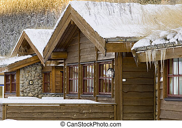 Norvegian wooden house in winter - View of wooden house in...