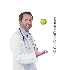 portrait of a doctor tossing green apple - Portrait of a...