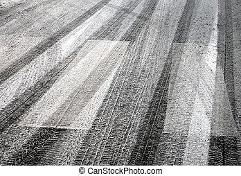 Tyre prints on asphalt