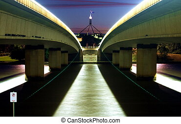 Commonwealth avenue bridge at night with parliament in...