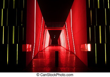 mysterious red dark alleyway lit up at night