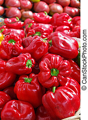 Pile of Red Bell Peppers at the farmers market with sharp...