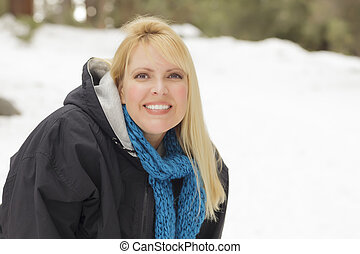 Attractive Woman Having Fun in the Snow