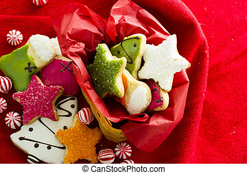 Christmas cookies - Assorted christmas cookies on red...