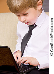 communicative youngster - picture of happy boy with black...
