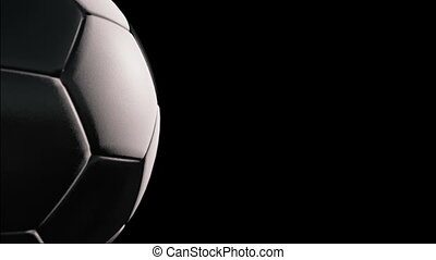 Soccer ball - Rotation on black background, loop