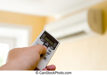 Air-Conditioner - Hand with control. Conditioner in the...