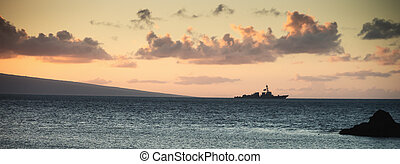 Us Navy Ship at Sunset - United States Navy ship underway...