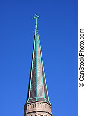 Church Spire - Church steeple with a blue sky background