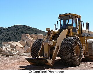 Construction Vehicle - A large yellow construction vehicle...