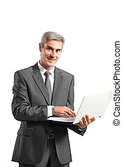 Smiling handsome businessman working with laptop. Isolated...