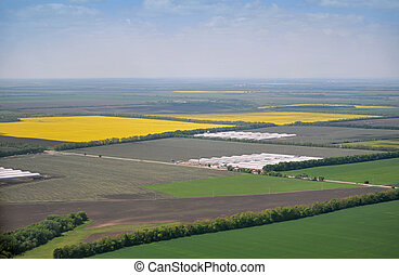 birds eye view of fields with farms and roads
