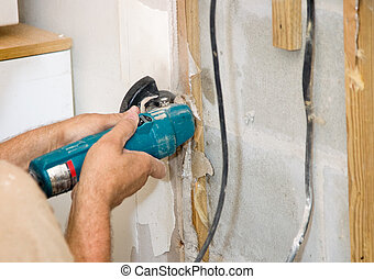 Cutting Drywall - Contractor using an angle grinder to cut...