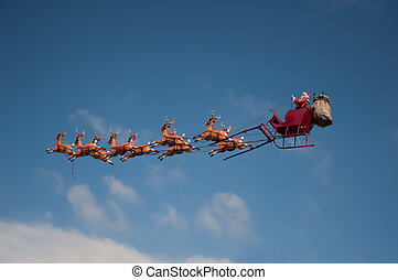 Santas Sleigh flying above the city during Christmas