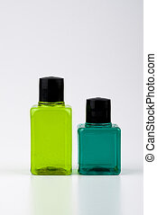 Two green color shampoo and bottles