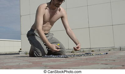 Man practices yoga on the roof. To do push-up on with their...