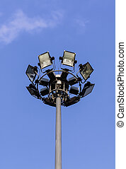 spotlight - Spotlight or floodlight tower in blue sky
