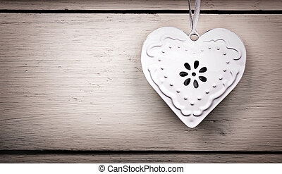 Vintage tin heart - A vintage tin heart hanging from a...