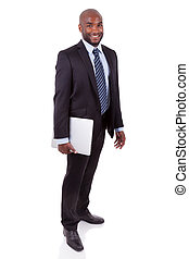 African Amercian business man holding a laptopn - African...