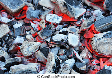 Hot coals for barbecue in the background