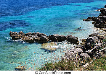 pictorial blue Ionian sea with rocks