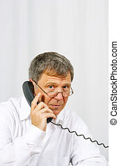 business man in office on the phone - business man in office...