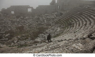 Tourist man visiting ancient  amphitheater at Myra