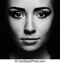 Mysterious portrait of a beautiful young woman. Black and...