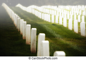 Military cemetery gravestones - Rows of white headstones at...