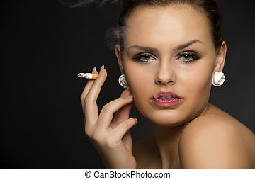 Stylish woman smoking a cigarette