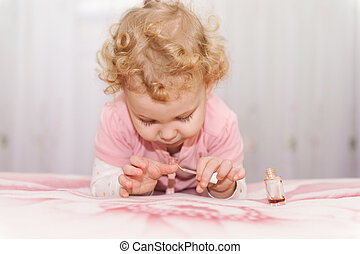 Cute baby playing with mothers manicure cosmetics - Cute...