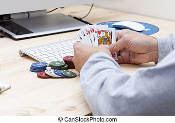 Poker online - Player playing poker and online betting