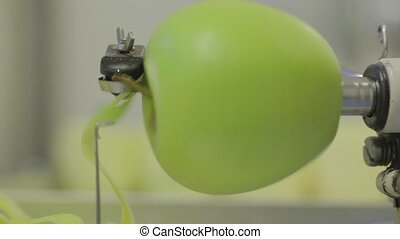 pealing a apple - a apple is being peeled with a peeling...