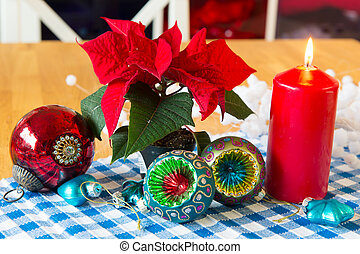 Christmas still life with balls and poinsetta plant