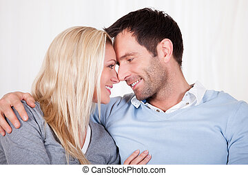 Romantic couple rubbing noses - Romantic young couple...