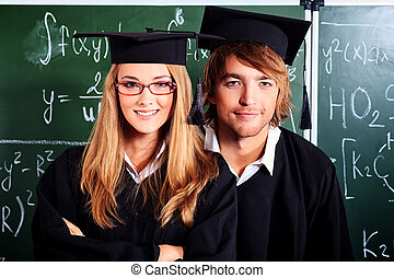 diploma - Portrait of a graduating students in an academic...
