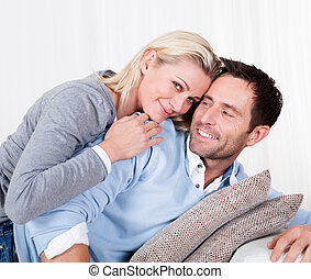 Happy man and woman cuddling