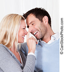 Woman touching her husband on the nose