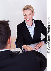 Female business executive smiling - A female business...